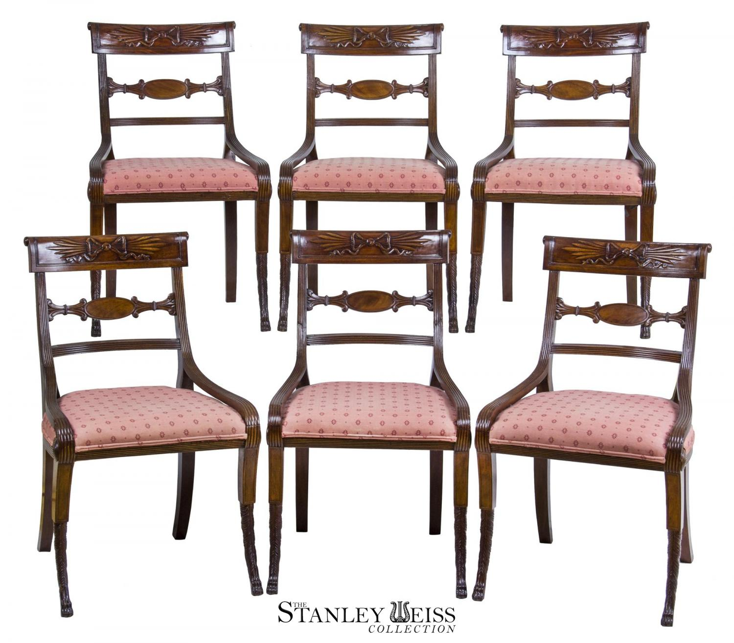 a fine and unique set of six classical mahogany dining chairs with